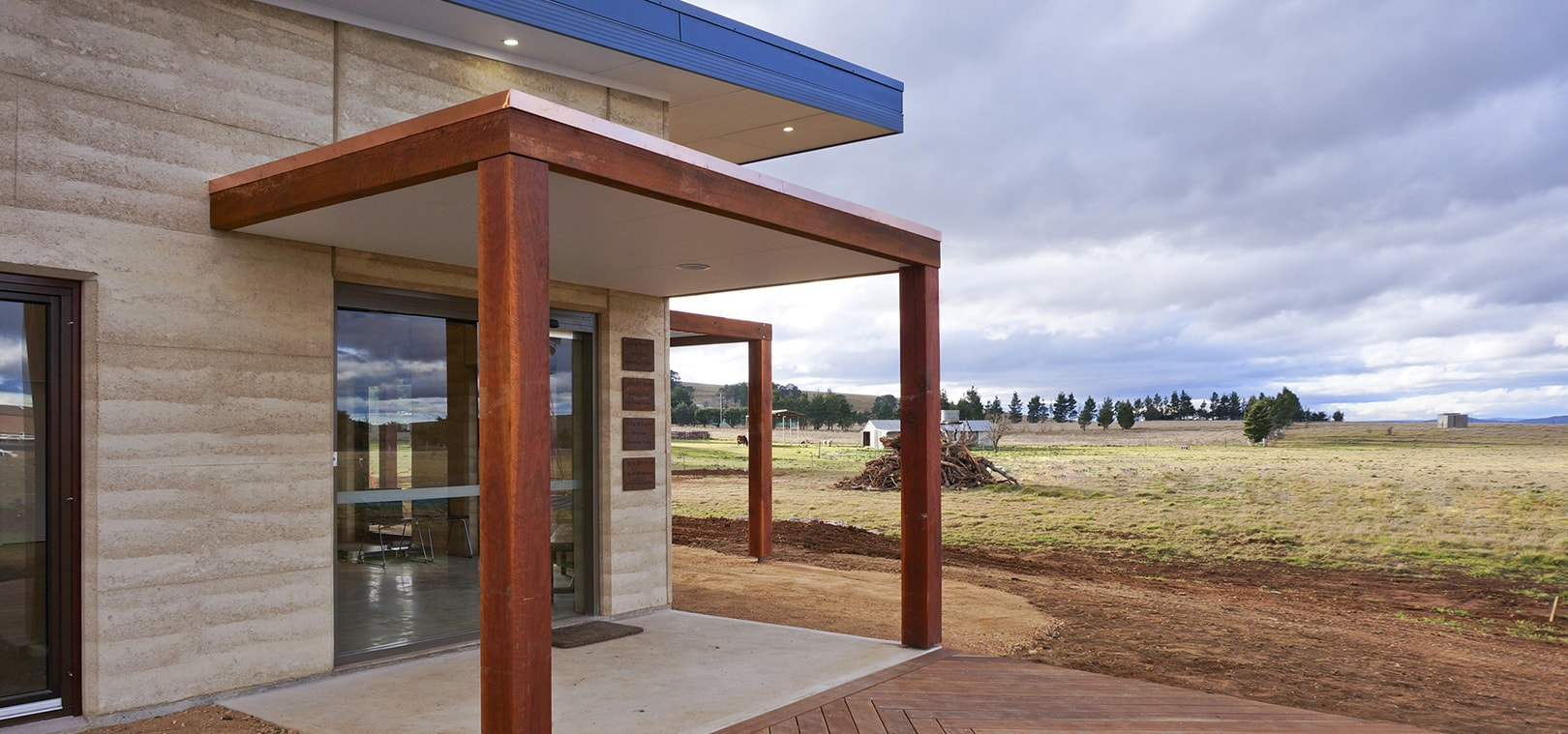 Rammed Earth building in a country landscape. Vet hospital by Architecture Republic, Bowral